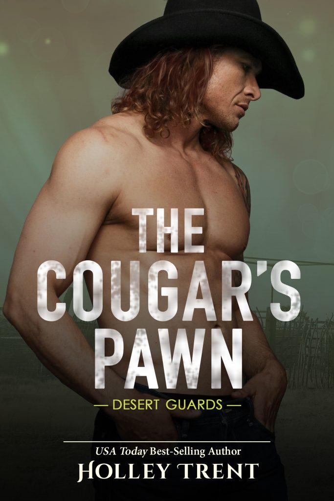 The cover of The Cougar's Pawn by Holley Trent contains a muscular shirtless man with dark red hair in a cowboy hat over a misty desert background