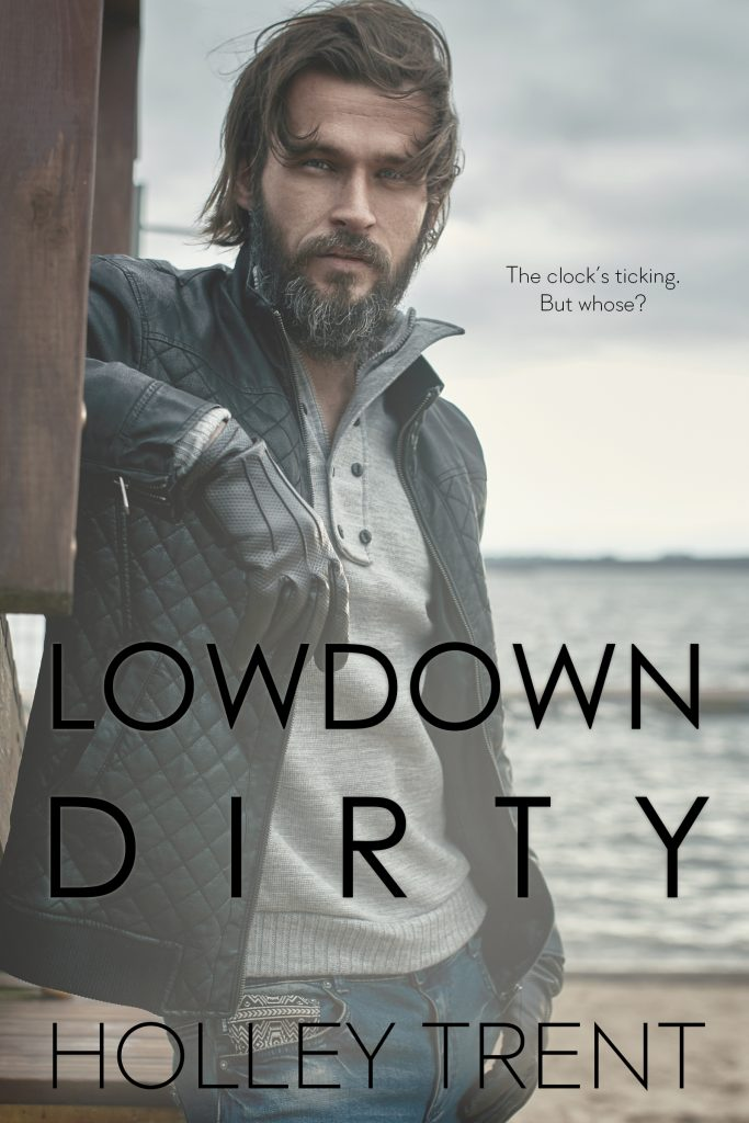 cover of Lowdown Dirty by Holley Trent features a man with thick beard with gray streaks standing in front of a beach