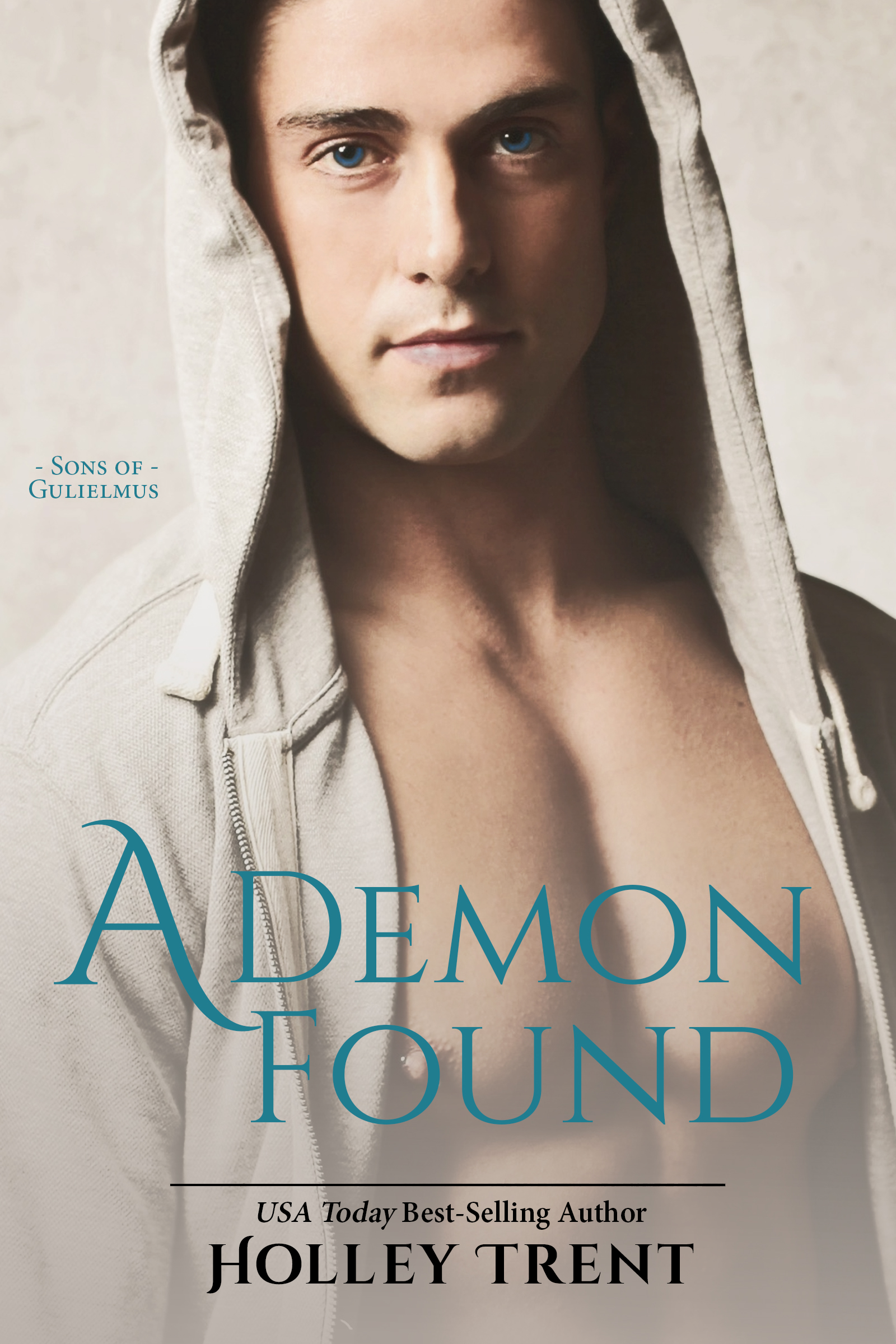 cover of A Demon Found by Holley Trent has a man in a beige hoodie sweatshirt open at the chest. He stares toward the camera with bright blue eyes.